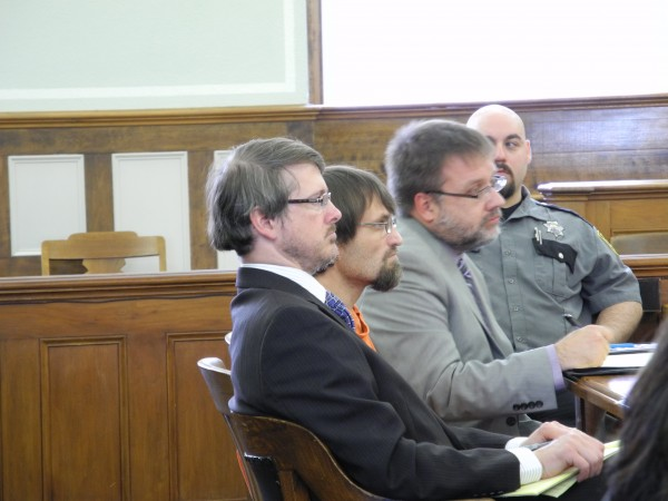 Convicted murderer Arnold Diana of Rockland, center, listens Friday afternoon as Justice Jeffrey Hjelm explains why he is sentencing him to 45 years in prison for the 2010 death of his ex-girlfriend, Katrina Windred of Friendship. Defense attorney Chris MacLean is on the left.