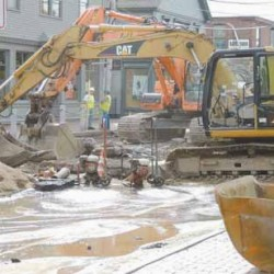 Pumps drain standing water from a section of Main Street where a 100-year-old water pipe burst Tuesday, leaving L.L. Bean's retail store without its primary fire sprinkler system for most of the day.
