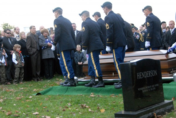 An honor guard departs from the coffin of Sgt. 1st Class Aaron Henderson during graveside services in Houlton on Wednesday, Oct. 10, 2012. Henderson, who grew up in Hodgdon, died at Bagram Air Force Base in Afghanistan on Oct. 2 from wounds suffered in an improvised explosives device attack on Sept. 30, 2012 in Helmand Province, Afghanistan.