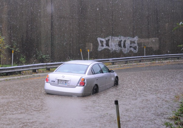 A disabled vehicle in the deep storm runoff on the I-395 onramp in Bangor.