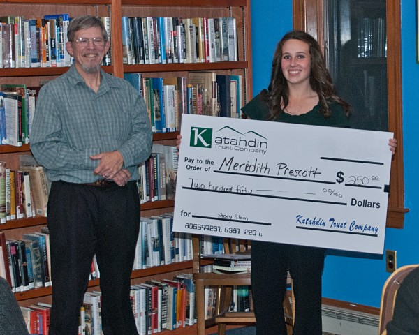 Story Slam judge, John Clark presents the Katahdin Trust check to October 18 winner Meredith Prescott