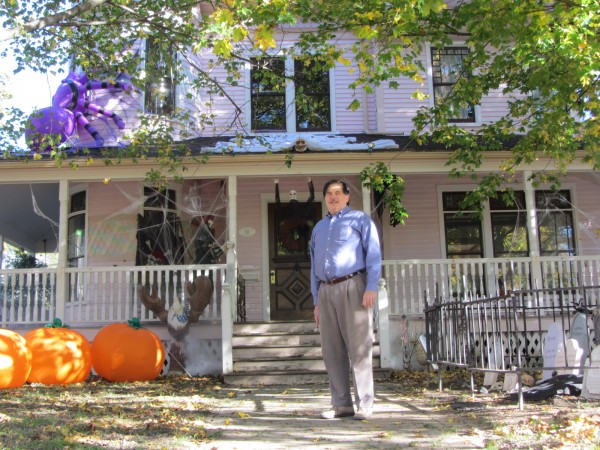 Brian Messing stands in front of his house that he has decorated and equipped to be a Halloween attraction for the community.