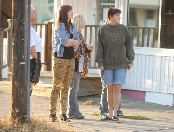 Spectators watch as Bangor police surround an apartment building at 27 Webster Ave. in Bangor on Monday, October 8, 2012.