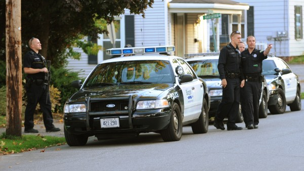 Bangor police spread out across Webster Avenue in Bangor on Monday, October 8, 2012 after reports of a pharmacy robbery at Rite Aid on Union Street.