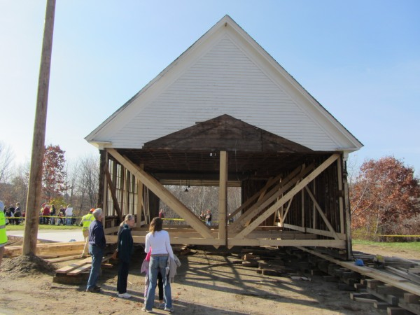 The move of the former Lincolnville Center School attracted both onlookers and participants from the community. Here, the school has been moved across the street.