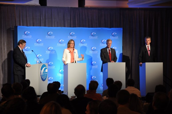 Candidates for the U.S. Senate (from the right), Republican Charlie Summers, independent Angus King, and Democrat Cynthia Dill speak during an Oct. 9 debate held by the Portland Regional Chamber of Commerce. Moderator Chris Hall is on the far left.