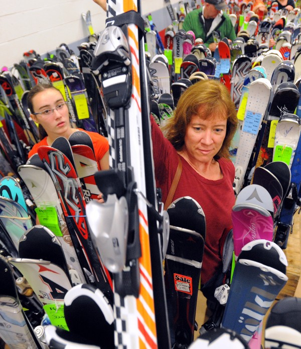 Tina Fife of Bangor helps her daughter Izzy Mahoney, 13, to find a pair of downhill skis with slightly different graphic design as they were looking for equipment during the Penobscot Valley Ski Club's annual ski sale Saturday.