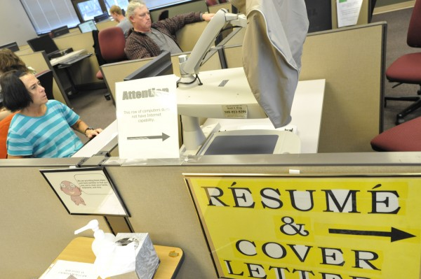 Kelly Boyer (left) and James Kent, both of Bangor, fill out online job applications at the Tri-County Career Center in Bangor on Wednesday afternoon, Sept. 22, 2011.