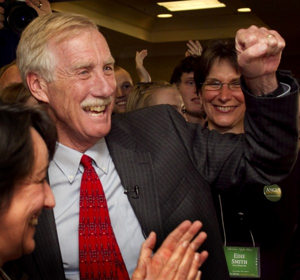 Sen-elect Angus King celebrates his victory Tuesday, in Freeport, Maine. King has yet to choose a party to caucus with in the Senate.