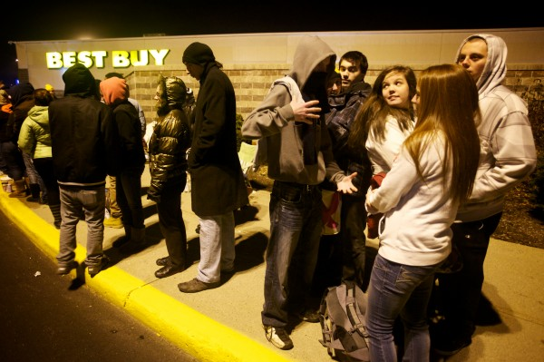 Hundreds of Black Friday shoppers queue up outside the Maine Mall in South Portland on Thursday night Nov. 22, 2012 just before midnight for a chance to get into Best Buy. The Mall opened at midnight, but the inside entrance to Best Buy did not open until 3 a.m.