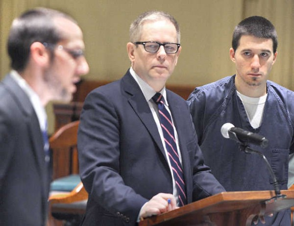 Steve Anctil (right) and his lawyer, James P. Howaniec (center), listen to Assistant District Attorney Andrew Matulis Tuesday morning in Androscoggin County Court in Auburn moments before Anctil pleaded guilty on a robbery charge stemming from the armed robbery of a meat salesman in Lewiston last May.