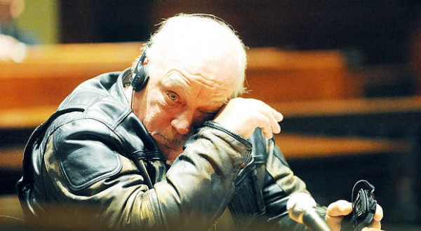 Everett H. &quotLenny&quot Leonard, 61, of Turner wipes his eyes as his ex-wife makes an emotional appeal for leniency during his sentencing in Androscoggin County Superior Court on Wednesday on charges of poaching deer and furnishing drugs. The headphones are part of a sound amplification system.