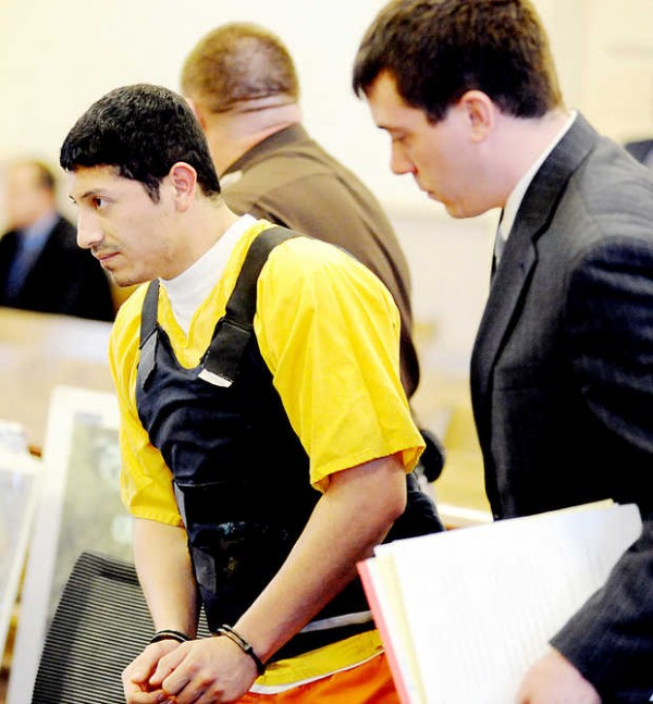 Juan Contreras enters the courtroom at the Franklin County Courthouse in Farmington with his attorney Christopher Berryment on Monday, Nov. 5, 2012.