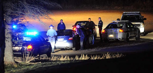 Police look into a Honda Civic that led Lewiston and Auburn police, Maine State Police and the Androscoggin County deputies on a chase around Lewiston and Auburn on Tuesday night.