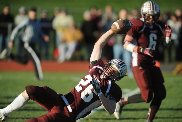 Foxcroft Academy Pony Don Boyer stretches the ball across the goal line late in the game on Saturday, Nov. 10, 2012, against John Bapst in Dover-Foxcroft. Foxcroft Academy won 33-7.