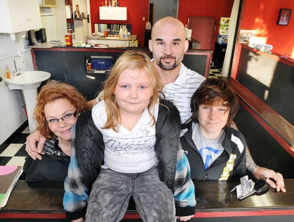 Aaron Aldrich, seen here wtih his wife, Angela, and his two children, Annabel, 8, and Owen, 12, hopes to convince the city of Lewiston to look past his felony convictions so he can get his tattoo license.