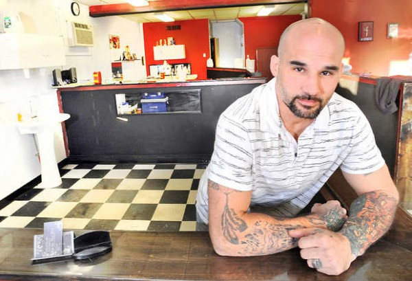 Aaron Aldrich has had a hard time getting his tattoo license from the city but hopes to soon be able to set up in the area behind him at Ink Junkies on Lisbon Street in Lewiston, where he was photographed Friday afternoon.
