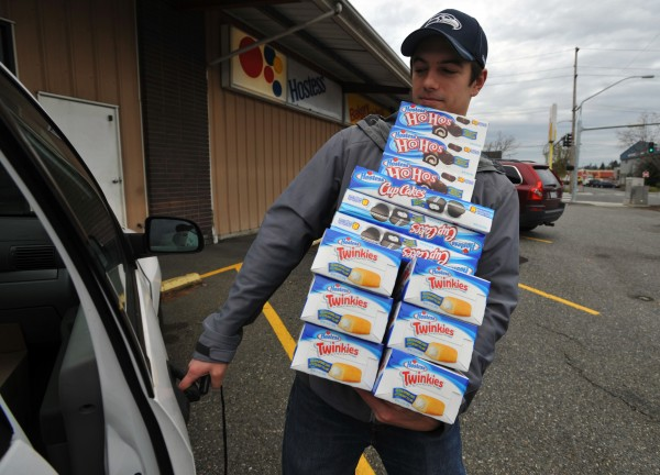 Andy Wagar loads Twinkies, Ho-Hos and cupcakes into a van outside the Wonder Bakery Thrift Shop in Bellingham, Washington, on Friday, November 16, 2012, after Hostess filed a motion to liquidate the company's holdings.