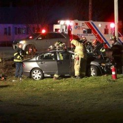 Rescue crews from the Sabattus Fire Department use a saw and the Jaws of Life to extricate a man trapped inside a Honda Civic after a Sunday evening crash at the intersection of Routes 126 and 9. The crash remains under investigation by the Sabattus Police Department.