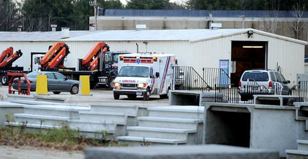A United Ambulance leaves American Concrete Industries Friday afternoon after a man was killed by a piece of concrete at the Auburn business.