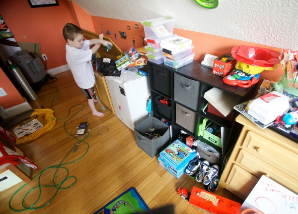 In his bedroom in Scarborough, Kyle St. Clair, 8, searches through his toy box while tethered to oxygen and medicine lines Thursday, Nov. 1, 2012.