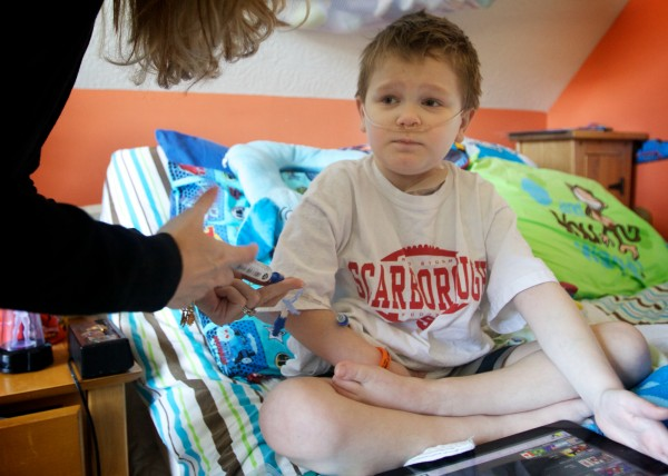 Kyle St. Clair, 8, gets a dose of powerful painkillers from his mother at their Scarborough home Thursday, Nov. 1, 2012.