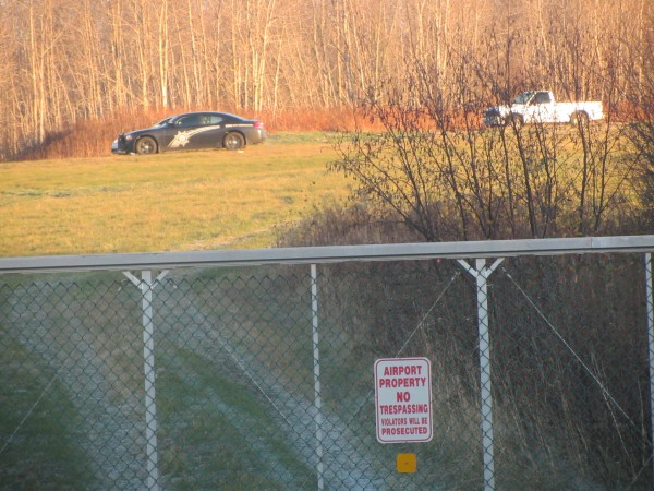 The pickup truck that was struck by the Cessna 172 that was taking off and then crashed Friday evening is seen on the runway at the Knox County Regional Airport on Saturday morning. A Knox County Sheriff's Office cruiser is parked in front of the vehicle, which has been impounded as part of the investigation