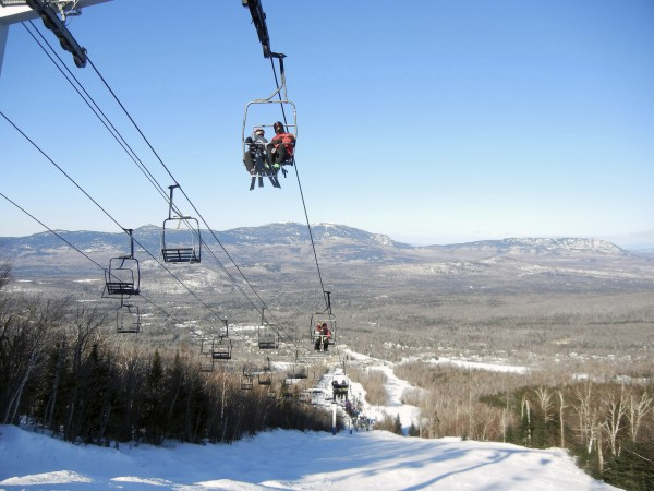 Skiers ride the Spillway East chairlift at Sugarloaf.