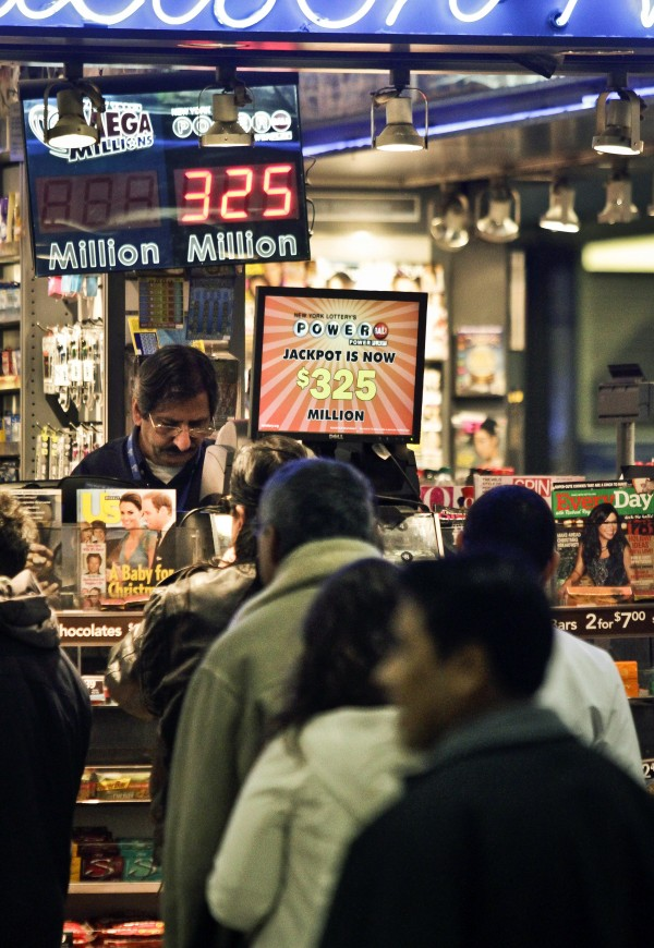 People wait in line to purchase lottery on Friday, Nov. 23, 2012 in New York. The jackpot for Powerball's weekend drawing has climbed to $325 million, the fourth-largest in the game's history. Powerball organizers say this is the first run-up to a large jackpot that's fallen over a major holiday.