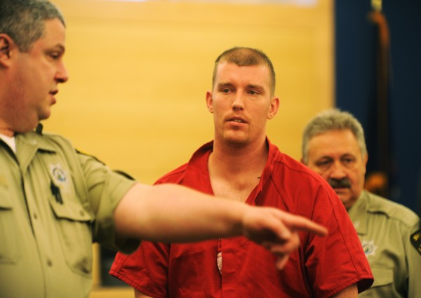 Nicholas Sexton (center) is directed to his seat at the Penobscot Judicial Center in Bangor Monday, Nov. 5, 2012, for his initial appearance in connection with the triple homicide of Daniel T. Borders, 26, of Hermon; Nicolle A. Lugdon, 24, of Eddington; and Lucas A. Tuscano, 28, of Bradford on Aug. 13 in Bangor.