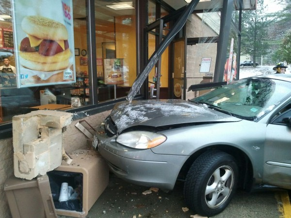 A Ford sedan crashed into the entrance of a Dunkin' Donuts in Paris on Thursday.