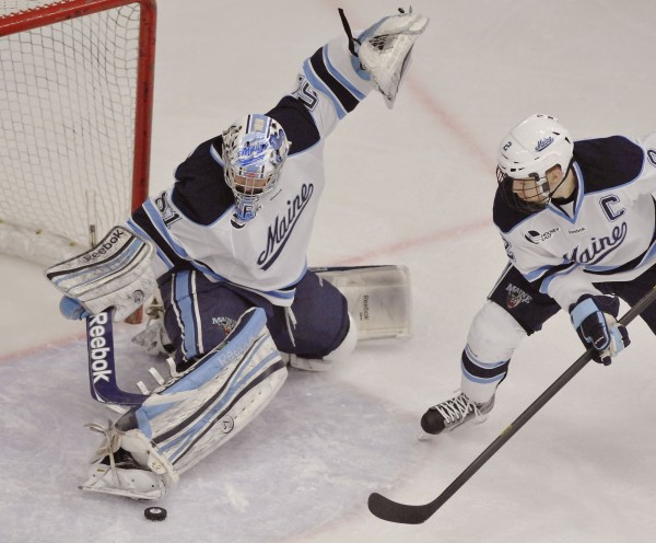 Maine goalie Martin Ouellette makes a skate save as defenseman Mike Cornell waits to clear the puck during a game against Boston College on Nov. 2. Ouellette has earned the staring goalie's job for the Black Bears.