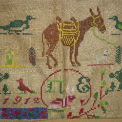 This cross stitch on burlap was found in a thrift shop in Seward, Neb., 20 years ago.