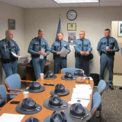 Colonel Williams (fourth from left) addresses a the group of Maine State Police troopers and Cumberland County Sheriff's Department deputies who were heading to New Jersey on Sunday morning, Nov. 4, 2012 to assist in the aftermath of Hurricane Sandy, which wreaked havoc on the region when it made landfall a week ago.