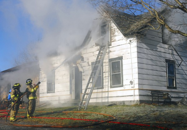 Firefighters fight a fire on Ridge Road in Plymouth on Friday, Nov. 30. According to officials, the house was a total loss, but everyone escaped safely.