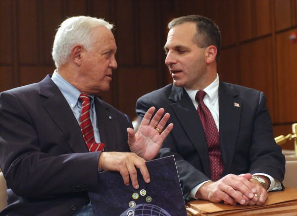 This Oct. 8, 2002 file photo shows former New Hampshire Sen. Warren Rudman, left, talking with former FBI Director Louis Freeh on Capitol Hill in Washington. Rudman, who co-authored a ground-breaking budget balancing law, championed ethics and led a commission that predicted the danger of homeland terrorist attacks before 9/11, has died. He was 82.