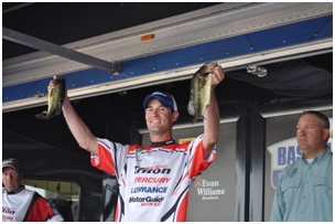 Jonathan Carter, 30, of Orrington, shows off the fish he caught while winning the 2012 Cabela's Bassmaster Federation Nation Eastern Divisional in Medford, Mass., on Sept. 12-14. Carter finished ninth in the Cabela's B.A.S.S. Federation Nation Championship in Decatur, Ala., on Oct. 25-27 and has qualified to compete in the Bassmaster Classic in Oklahoma Feb. 22-24, 2013.