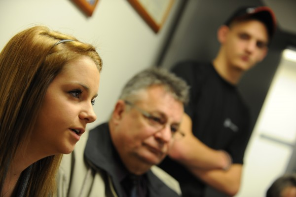 Alexis Henkel, left, talks about her recent bullying with her father Norbert, center, and brother Austin, right, and her mother Judy, not pictured. The Henkel family met with the Bangor Daily News at the Veazie police station on Friday, November 9, 2012 to discuss the problem of cyber bulling.