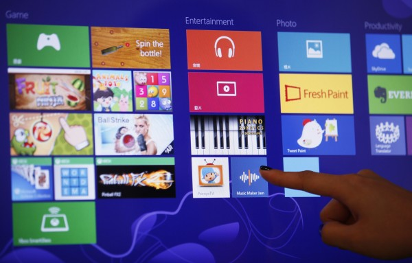 An attendant demonstrates &quotlive tiles&quot in the Microsoft Windows 8 operating system during its launching ceremony in Hong Kong Friday, Oct. 26, 2012.