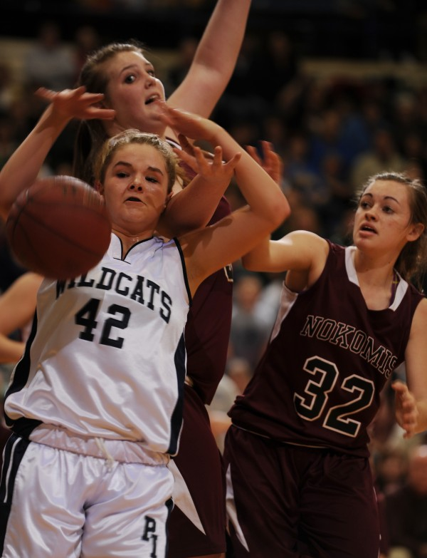 Presque Isle's Krystal Kingsbury (left) and Nokomis' Traci Carson (center) along with Taylor Shaw all vie for a rebound during the Eastern Maine Class B final last February in Bangor. Kingsbury is among the more than 175 basketball players who have confirmed they plan to participate in the third annual MBNation East vs. West Showcase on Sunday in Saco.