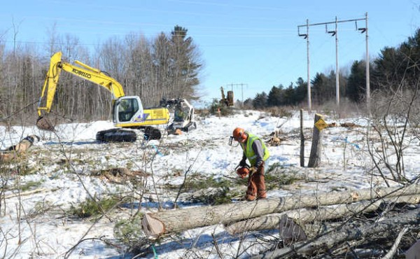 Crews from Asplundh Tree Expert Co. work on expanding CMP's power line corridor near Merrill Road in Lewiston in 2011. The Maine Public Utilities order that authorized the expansion also directed CMP on taking trees outside its rights of way for all power-line corridors in Maine.