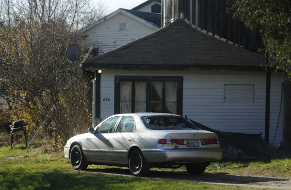 A Toyota Camry with windows smashed out sits in the yard of the house at 626 Route 1 in Stocton Springs  on Saturday, November 17, 2012. Spokesman Stephen McCausland of the Public Safety Department said David Linscott of Brooks was shot at about 12:30 a.m. Saturday in the front yard of a house owned by 36-year-old Robert Tucker along U.S. Route 1. Linscott died at the scene of a single gunshot wound.