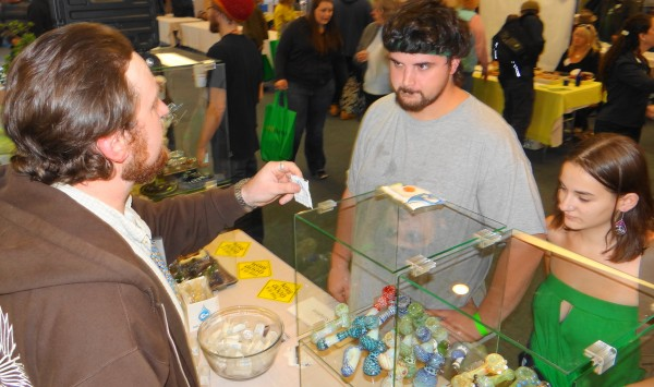 Exhibitor Kyle Orce (left) of Fresh Solutions LLC describes his wares to David Sturdee and Nesa Webber of Nobleboro at the Medical Marijuana Caregivers of Maine trade show in Portland.
