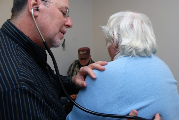 Dr. Noah Nesin examines 74-year-old Lorraine Paradis at Health Access Network in Lincoln on Friday, Nov. 23, 2012. Nesin will end about 26 years of medical practice in the Lincoln area when he takes a new job in spring 2013.