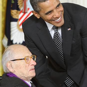 2011 National Medal of Arts recipient and painter/printmaker Will Barnet receives his medal from President Barack Obama at an East Room ceremony at the White House in February 2012.