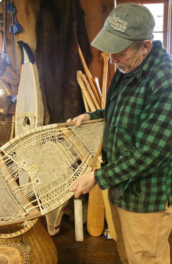 Milford artisan Bill Mackowski holds a pair of snowshoes he made during the winter of 2010 in his at-home gallery on Nov. 10, 2012. The snowshoes are his re-creation of a pair of Penobscot snowshoes made in the 1850s, which are currently on display at the Abbe Museum in Bar Harbor, and it is the most intricate and difficult design he has found in his decades-long study of traditional snowshoes.