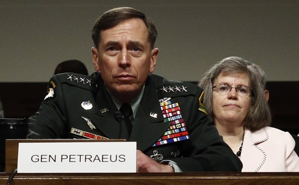U.S. General David Petraeus, with his wife Holly seated behind him, testifies at his Senate Armed Services Committee confirmation hearing to become commander of U.S. forces in Afghanistan on Capitol Hill in June 2010. The scandal that felled CIA Director Petraeus widened on Nov. 13, 2012, to snare the top U.S. commander in Afghanistan, Marine General John Allen, who was being investigated for &quotflirtatious&quot communications with a woman at the center of the case.