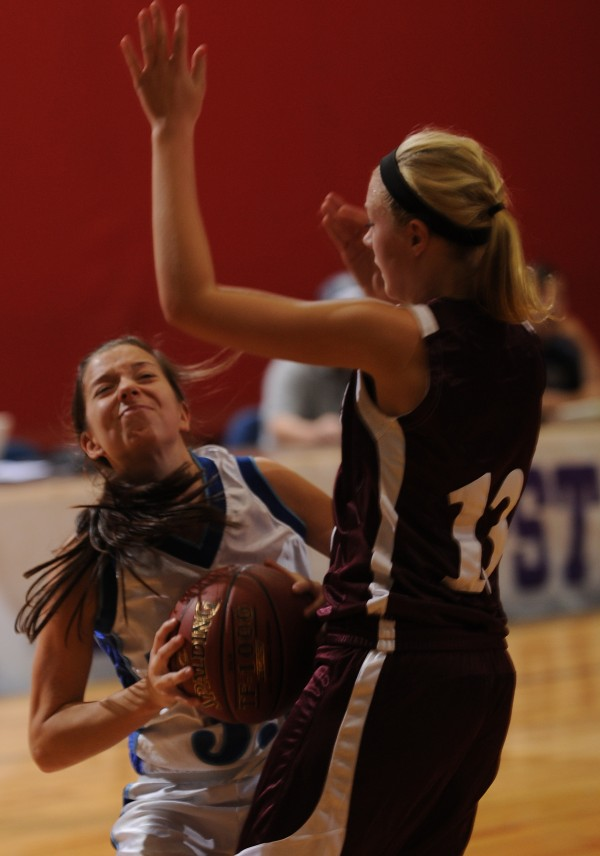 Stearns' Alex Mooney (left) has her shot blocked by Foxcfrot's Amber Anderson during the John Bapst preseason basketball tournament at the Bangor Auditorium on Saturday, Nov. 24, 2012. Stearns won 45-39.