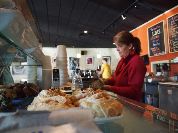 Sue Elliott, who started working at the Royal Bean about two weeks ago, rings up a customer at the newly reopened coffee shop on Main Street in Yarmouth on Monday, Nov. 19, 2012.