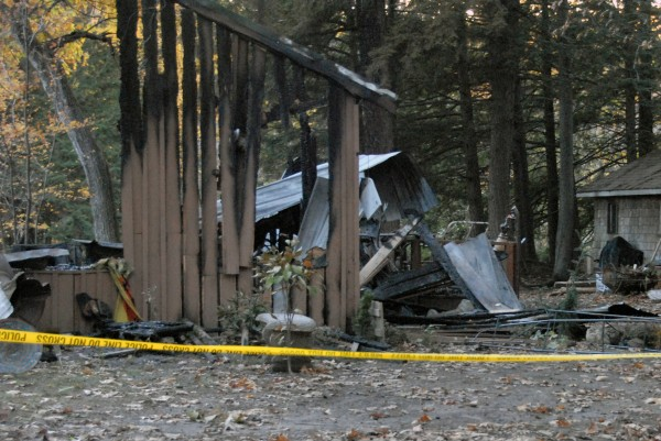Investigators are working to determine what started the fire that destroyed a cabin in Grindstone on Saturday, Oct. 14, 2012.